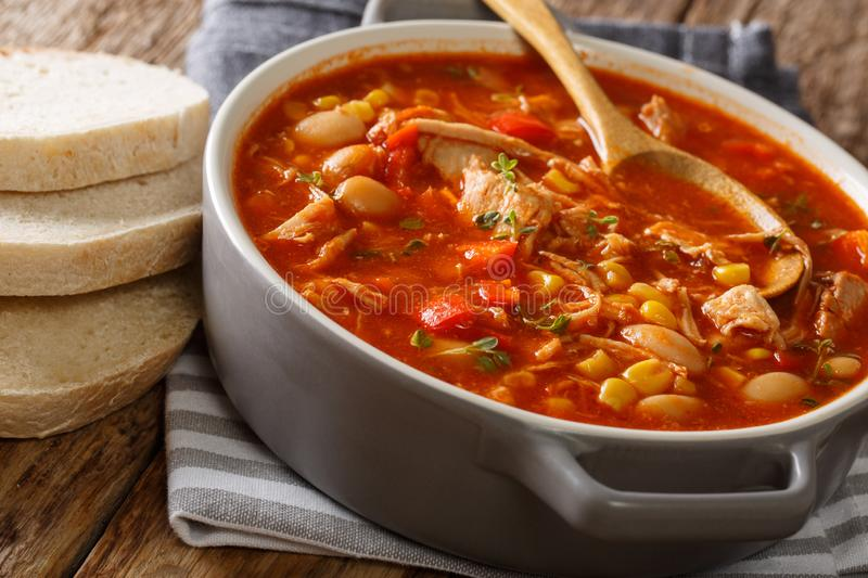 South American food Brunswick Stew pulled meat with vegetables o. N chicken broth and barbecue sauce close-up in a pot on the table. horizontal royalty free stock photography