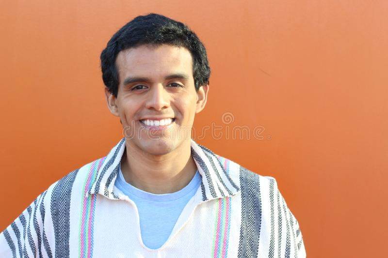South American man wearing a traditional poncho stock image