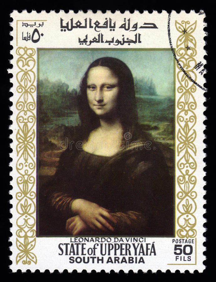 South Arabia postage stamp Mona Lisa. Upper Yafa, South Arabia postage stamp with a portrait image of the smiling Mona Lisa by the medieval Renaissance artist stock photo