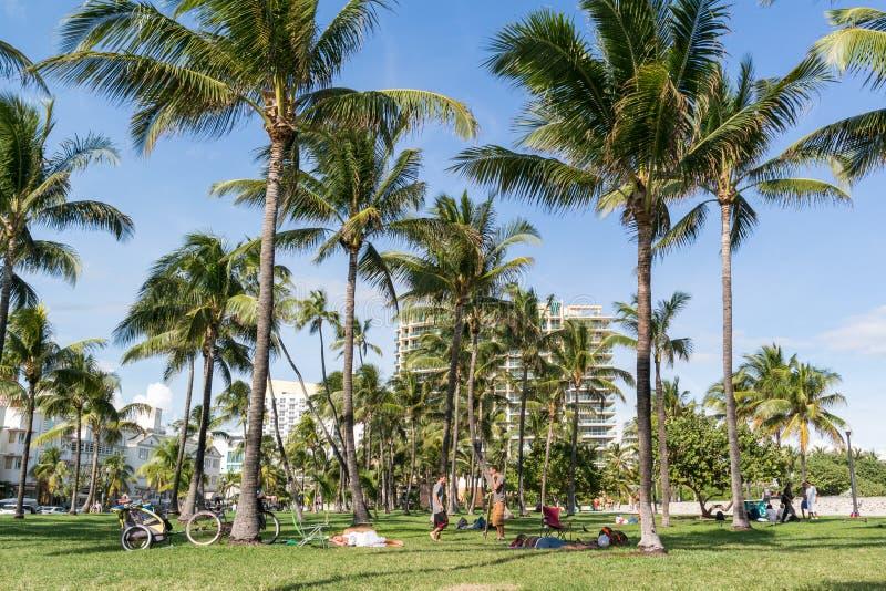 South Beach Boardwalk, Miami Beach, Florida. South Beach Boardwalk with people and palm trees in Miami Beach, Florida, USA stock photo
