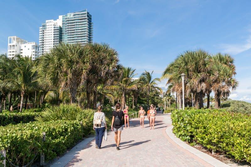 South Beach Boardwalk, Miami Beach, Florida. People walking on South Beach Boardwalk in Miami Beach, Florida, USA royalty free stock photo