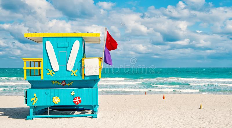 South Beach in Miami, Florida. South Beach, Miami, Florida, lifeguard house in a colorful Art Deco style on cloudy blue sky and Atlantic Ocean in background royalty free stock images