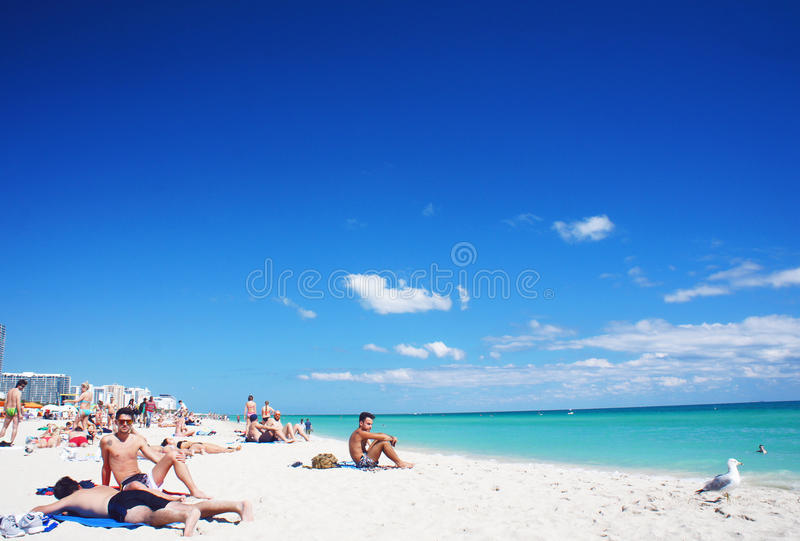 South Beach of Miami near Atlantic Ocean. Miami Beach, United States - February 12, 2016: People walk and relax at the sunny South Beach of Miami near Atlantic stock images