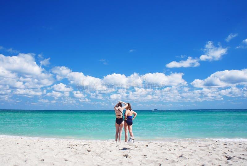 South Beach of Miami near Atlantic Ocean. Miami Beach, United States - February 12, 2016: People walk and relax at the sunny South Beach of Miami near Atlantic stock photography