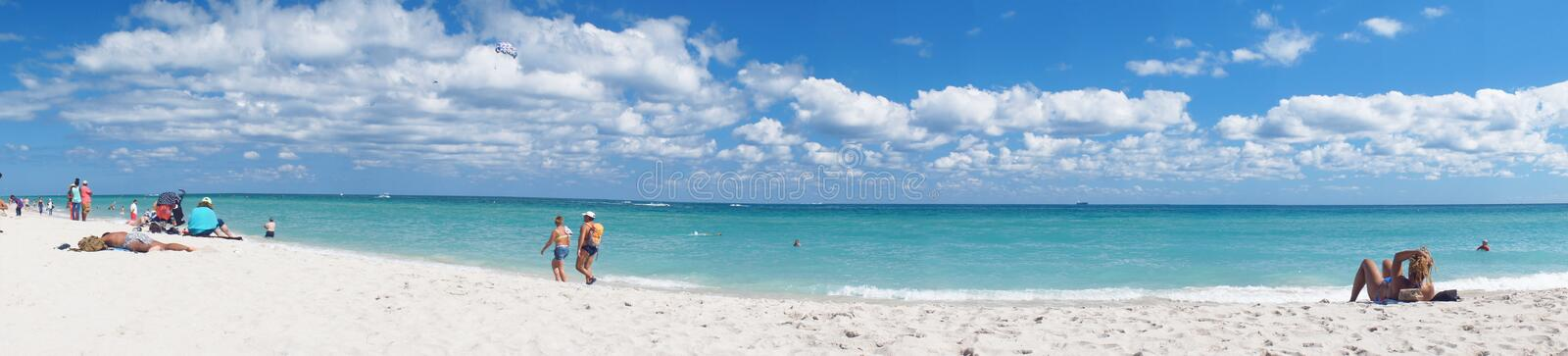 South Beach of Miami vacation panorama. Miami Beach, United States - February 12, 2016: People walk and relax at the sunny South Beach of Miami near Atlantic stock photo