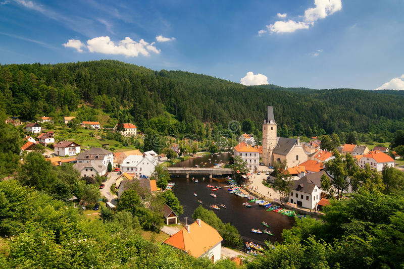 South Bohemian town Rozmberk nad Vltavou. View of the city and river rafting stock image