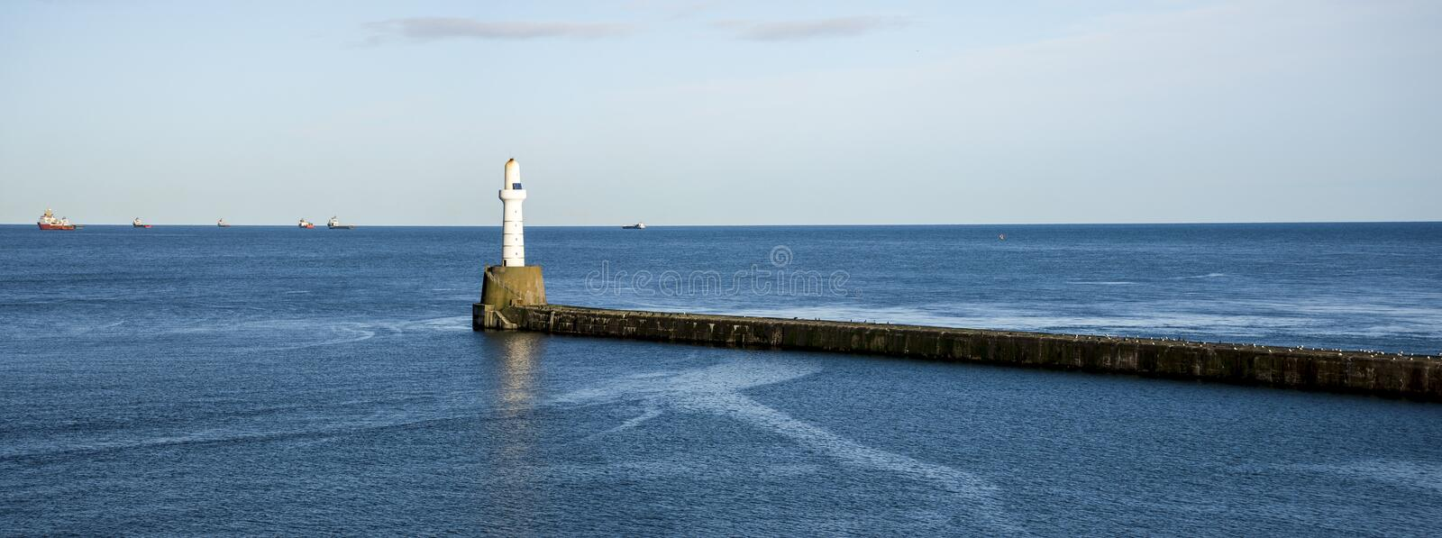 South breakwater lighthouse at the entrance to Aberdeen harbor, Scotland, United Kingdom. November 2017 royalty free stock image