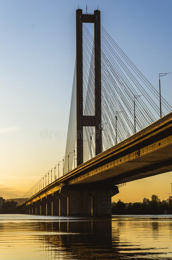 South bridge, Kyiv, Ukraine. Kyiv bridge over the Dnipro river against the backdrop of a beautiful sunset. Evening sun royalty free stock photography