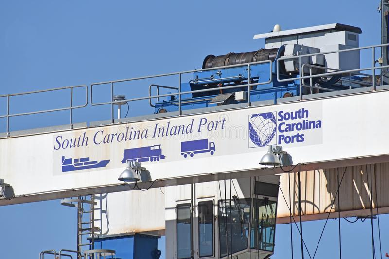 South Carolina Inland Port Crane with logo. A gantry spreader crane at South Carolina Inland Port Greer is pictured royalty free stock images