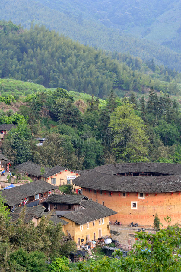 South Chinese Village And Earth Castle Among Mountains Editorial Stock Image