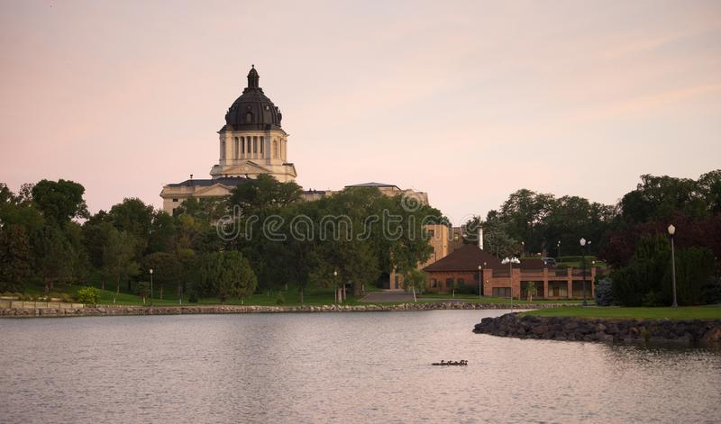 South Dakota State Capital Building Hughes County Pierre SD. Water from the lake reflects the building in front of the capitol dome in Pierre, SD royalty free stock photos