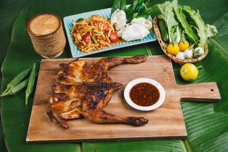 South East and East Asia: Typical Asian Food, Grilled Chicken with papaya salad served on plate, Thai Northeast food style stock photos