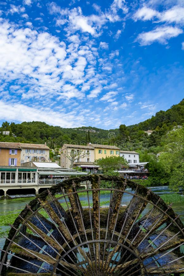 South of France, view on small Provencal town of poet Petrarch Fontaine-de-vaucluse with emerald green waters of Sorgue river. South of France, view on small royalty free stock photography