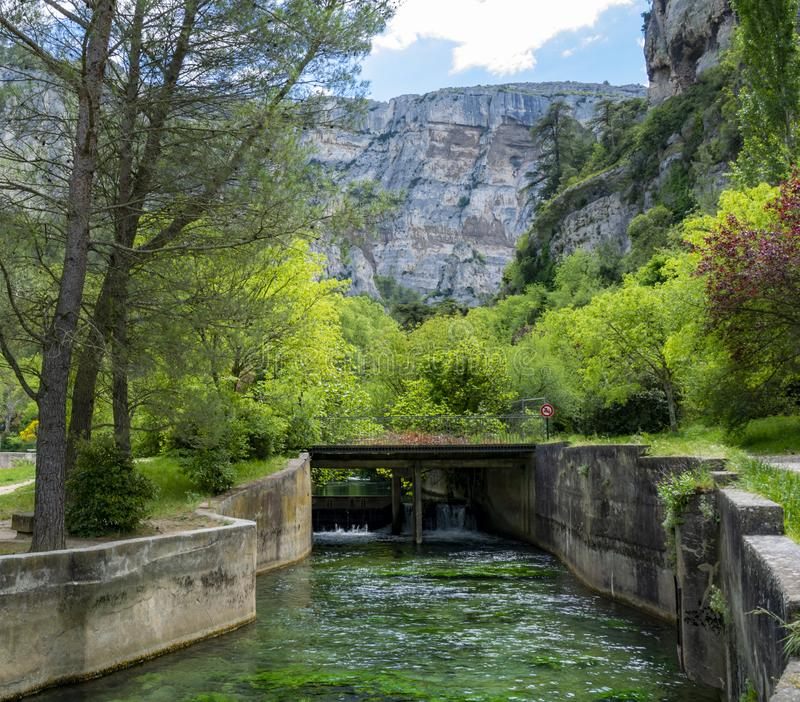 South of France, view on small Provencal town of poet Petrarch Fontaine-de-vaucluse with emerald green waters of Sorgue river. South of France, view on small stock photo