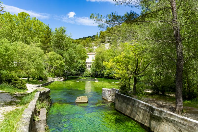 South of France, view on small Provencal town of poet Petrarch Fontaine-de-vaucluse with emerald green waters of Sorgue river. South of France, view on small royalty free stock photos