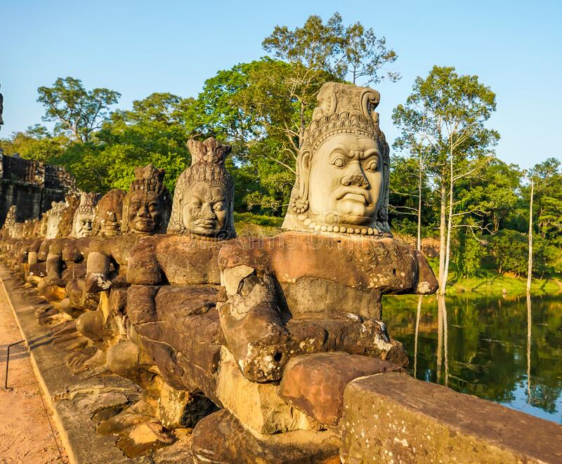 South gate bridge of Angkor Thom with statues of gods and demons royalty free stock photo