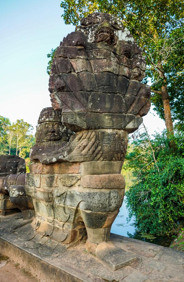 South gate bridge of Angkor Thom with statues of gods and demons stock image