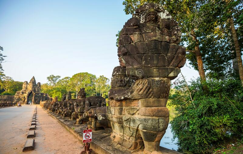 South gate bridge of Angkor Thom with statues of gods and demons royalty free stock photography