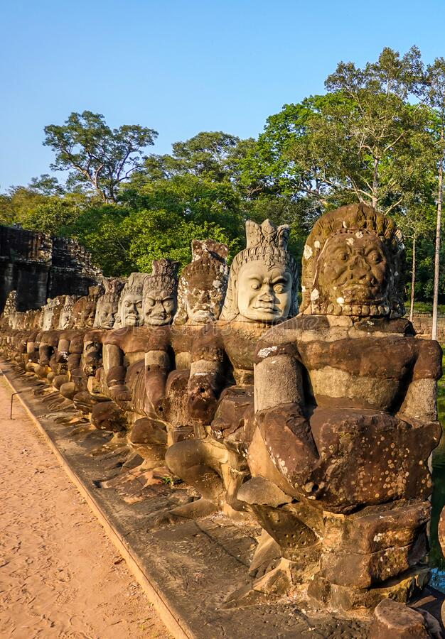 South gate bridge of Angkor Thom with statues of gods and demons stock photography
