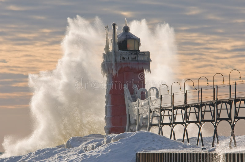 South Haven Lighthouse Winter. South Haven, Michigan Lighthouse winter, Lake Michigan with ice glaze and crashing wave royalty free stock photos