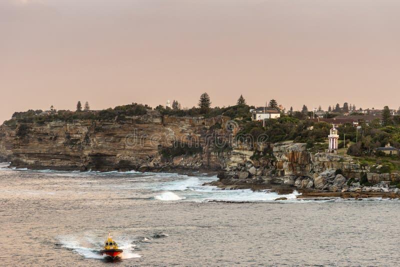 South Head cliffs, crashing waves, boat and Tasman sea gate, Sydney Australia. Sydney, Australia - February 12, 2019: South Head cliffs at gate between Tasman stock photos