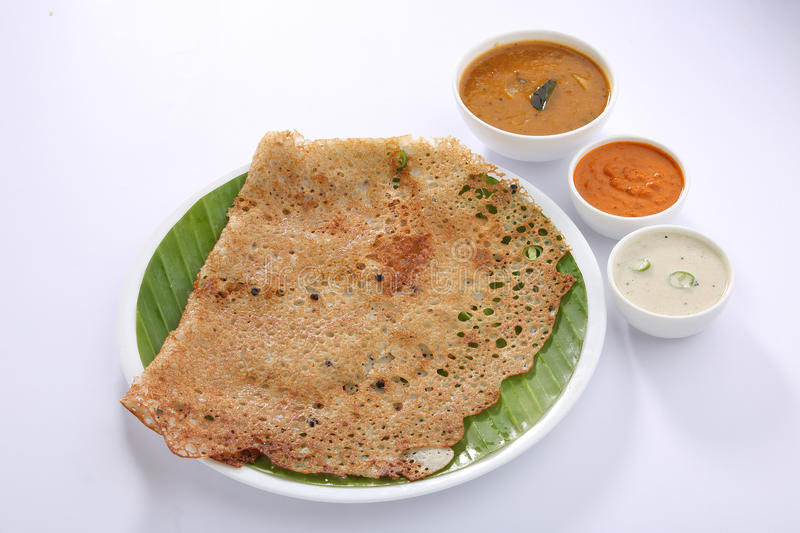 South indian break fast. Rava Dosa is a popular South Indian thin and crispy flat bread. It looks like thin crepes. This is a mouthwatering culinary delight stock photography