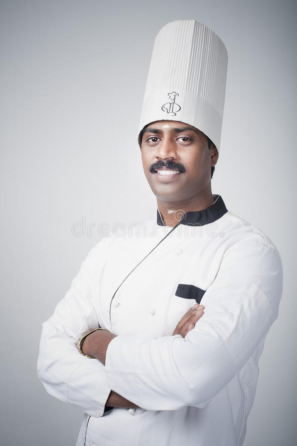 Free South Indian Chef Standing With His Arms Crossed And Smiling Royalty Free Stock Photo - 36256085