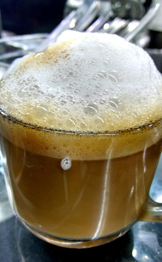 South Indian filter Coffee. Served in a transparent cup stock images