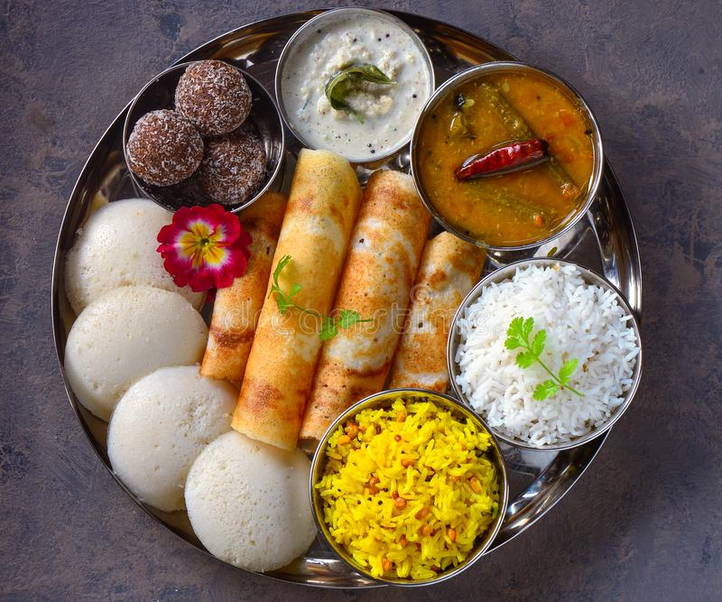 South Indian gluten free vegetarian platter in steel plate. South Indian vegetarian platter in steel plate, dosa, pancake, rice, idli, steamed, fermebted royalty free stock photography