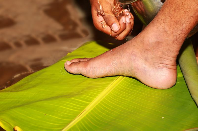 South Indian Hindu Wedding tradition, Groom and Bridal Legs and Hands Ceremonial stock photos