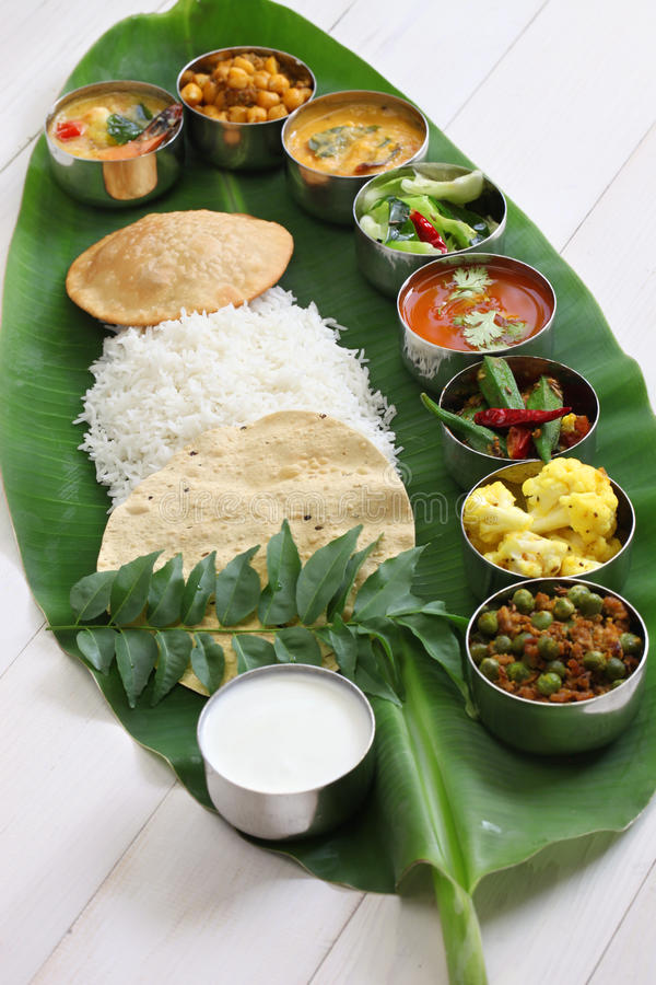 South indian meals served on banana leaf stock photo for Abhiruchi south north indian cuisine