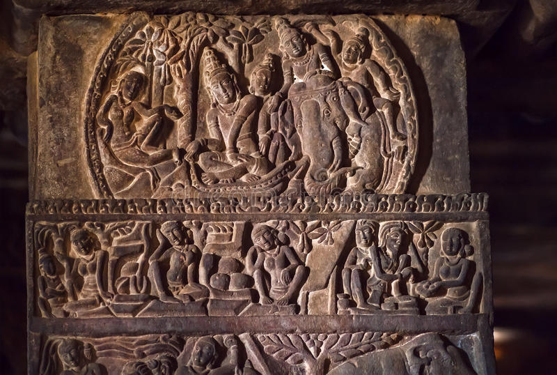 South Indian people and life in ancient villages, carved wall inside the 7th century temples in Pattadakal, India. UNESCO World Heritage site stock photo