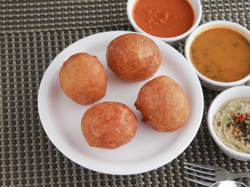 South Indian snack Mysore Bhajji with sambar & chutneys. South Indian snack Mysore Bhajjis with sambar. Can be eaten anytime, anywhere royalty free stock images