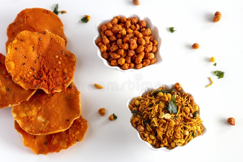 South indian spicy crunchy mix Nimco or Namkeen with peanut, rice, curry leaves and spice white bowl background isolated royalty free stock photos