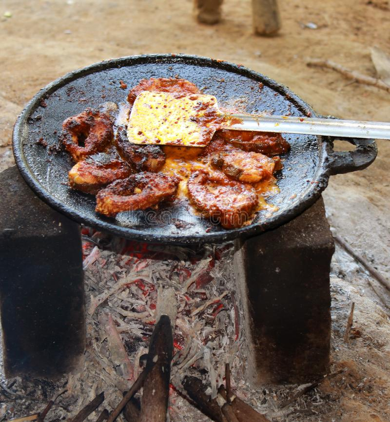 South indian traditional cooking of fish fry. royalty free stock photos