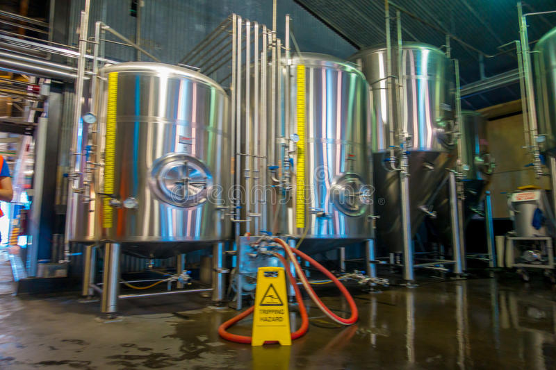 SOUTH ISLAND, NEW ZEALAND- MAY 25, 2017: Modern Beer Factory, steel tanks for beer fermentation and maturation. Monteiths beer factory, south island in New stock photos