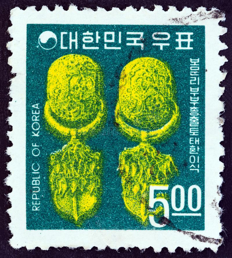 SOUTH KOREA - CIRCA 1968: A stamp printed in South Korea shows 5th-6th century Earrings, circa 1968. royalty free stock image