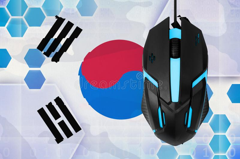 South Korea flag and computer mouse. Concept of country representing e-sports team. South Korea flag and modern backlit computer mouse. Concept of country royalty free stock photography