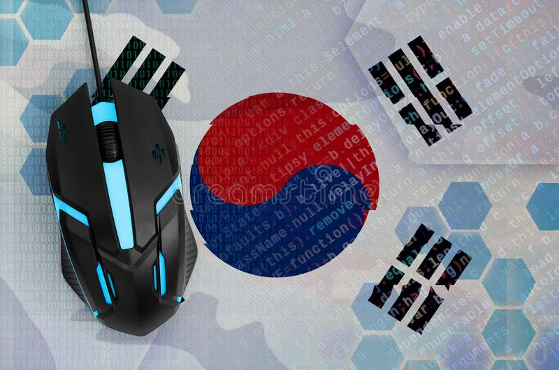 South Korea flag and computer mouse. Digital threat, illegal actions on the Internet. South Korea flag and modern backlit computer mouse. The concept of digital stock images