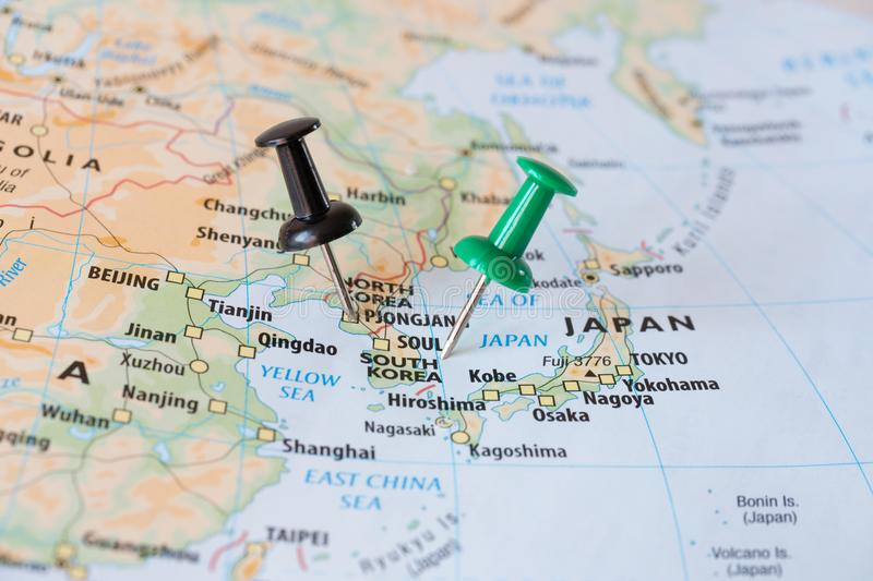 South Korea and North Korea map with pins world hot spot concept. Pins on South Korea and North Korea on a map, world hot spot concept royalty free stock image