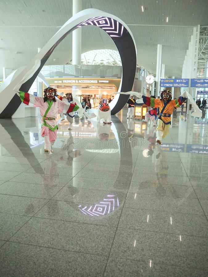 Dancers performing a traditional Korean mask dance in the recently opened Incheon International stock images