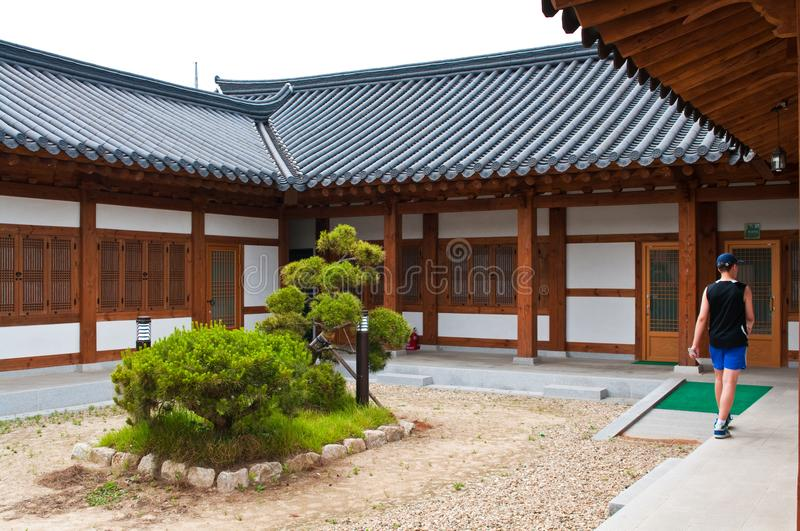 South Korea old house or home with European tourist. A young European tourist visiting a retro South Korea house or home. Abstract Asian Korean architecture stock images