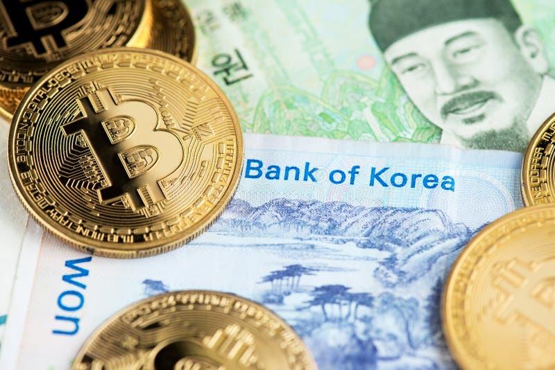 South Korea Won banknotes and Bitcoin Cryptocurrency coins close up image. South Korea Won banknotes and Bitcoin BTC  Cryptocurrency coins close up image stock images