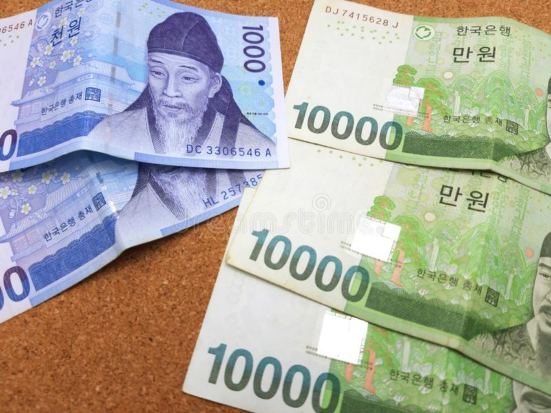 South Korean Won. Bank note arrange on the cork table stock photo