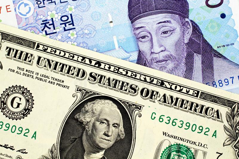 South Korean 1000 Won Note With American One Dollar Bill. A South Korean 1000 won note with an American one dollar bill royalty free stock images