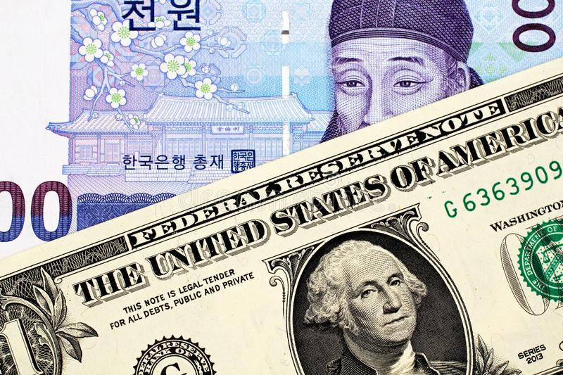 South Korean 1000 Won Note With American One Dollar Bill. A South Korean 1000 won note with an American one dollar bill royalty free stock photos