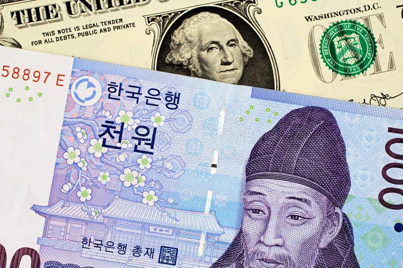 South Korean 1000 Won Note With American One Dollar Bill. A South Korean 1000 won note with an American one dollar bill stock images
