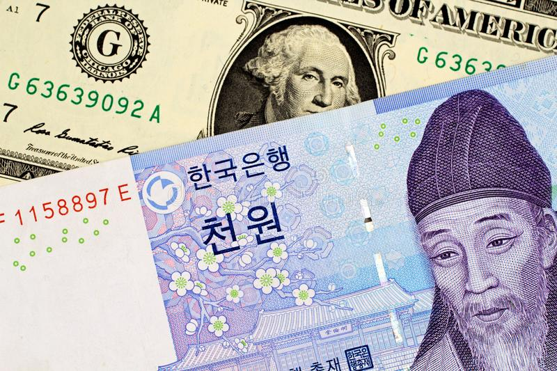 South Korean 1000 Won Note With American One Dollar Bill. A South Korean 1000 won note with an American one dollar bill stock photo