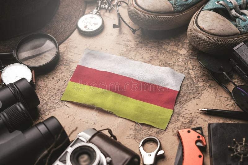 South Ossetia Flag Between Traveler`s Accessories on Old Vintage Map. Tourist Destination Concept.  stock photos