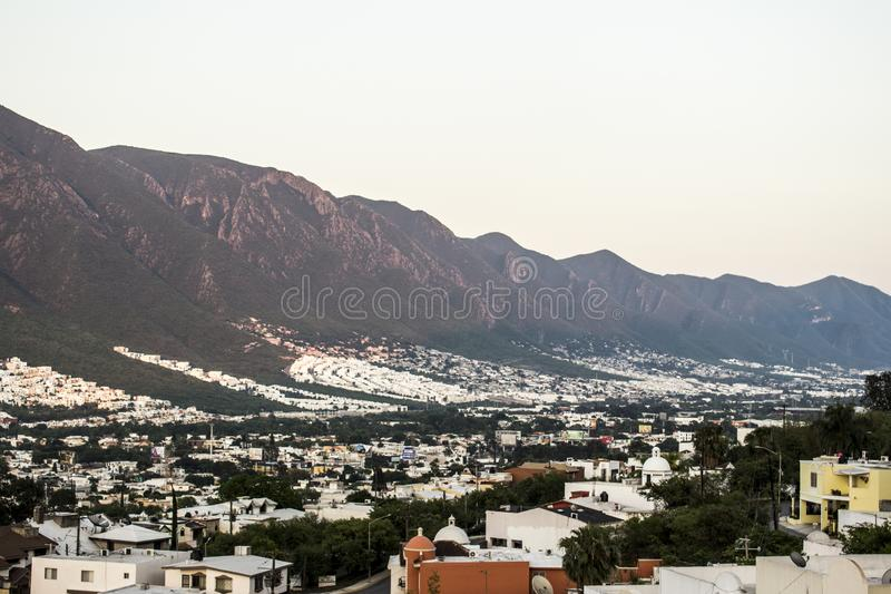 South part of the city of Monterrey, Nuevo Leon, Mexico. Mostly a suburban area near the hills. A part of the Cerro de la Silla is easily visible. It's stock images